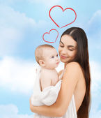 Happy mother with adorable baby — Стоковое фото