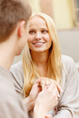 Romantic man proposing to beautiful woman — Stock Photo