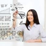 Smiling woman drawing plan on virtual screen — Stock Photo #37405049