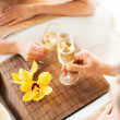 Woman and man hands with champagne glasses — Stock Photo