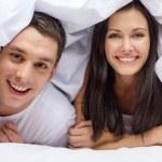 Happy couple sleeping in bed — Stock Photo #37405715
