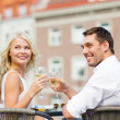 Smiling couple drinking wine in cafe — Stock Photo #37406271