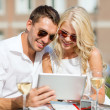 Couple looking at tablet pc in cafe — Stock Photo #37406331