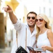 Couple with map, camera and travellers guide — Stock Photo #37406513