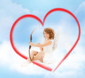 Happy teenage angel girl with bow and arrow — Stock Photo