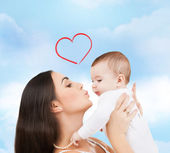 Happy mother kissing her child — Stock Photo