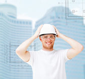 Male architect in white helmet with safety glasses — Stock Photo