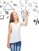 Girl in white shirt drawing idea on virtual screen — Stock Photo