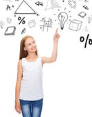 Girl in white shirt pointing to idea — Stock Photo