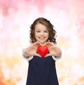 Beautiful girl with small heart — Stock Photo