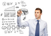 Buisnessman drawing plan on virtual screen — Stock Photo