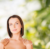 Beautiful woman touching her shoulders — Stock Photo