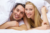 Happy couple sleeping in bed — Stock Photo
