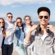 Teenage boy with sunglasses and friends outside — Foto de Stock