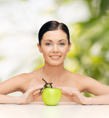 Beautiful woman with green apple — Stock Photo
