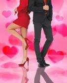 Man in pak en vrouw in de rode jurk — Stockfoto