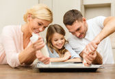 Happy family in making cookies at home — Stock Photo
