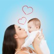 Happy mother kissing her child — Stock Photo #37534831
