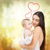 Happy mother feeding her adorable baby — Stock Photo