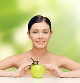 Beautiful woman with green apple — Stock Photo