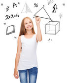 Smiling girl in blank white shirt drawing triangle — Stock Photo