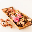 Closeup of pot-pourri in wooden bowl — Stockfoto