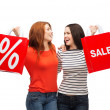 Two smiling teenage girl with shopping bags — Stock Photo #37591007