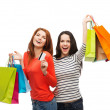 Teenage girls with shopping bags and credit card — Stock Photo #37591125