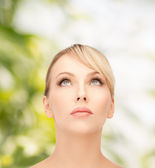 Beautiful woman looking up — Stock Photo