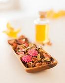 Closeup of essential oil, flowers and pot-pourri — Stock Photo