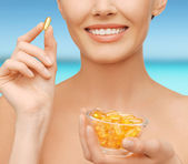 Beautiful woman with omega 3 vitamins — Stock Photo