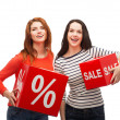 Stock Photo: Smiling teenage girl with percent and sale sign