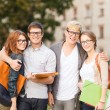Group of students or teenagers hanging out — Stock Photo #38357631