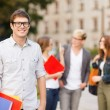 Teenage boy with classmates on the back — Stock Photo #38357725