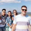 Stock Photo: Teenage boy with sunglasses and friends outside
