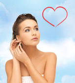 Woman wearing shiny diamond earrings — Stock Photo