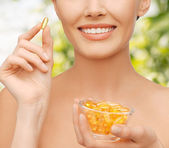 Beautiful woman with omega 3 vitamins — Stock Photo