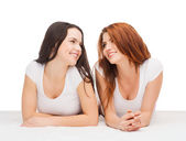 Two laughing girls in white t-shirts — Stock Photo