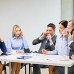 Business team with smartphones having conversation — Stock Photo