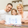 Happy family drawing at home — Stock Photo