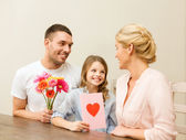 Happy family celebrating mothers day — Stock Photo