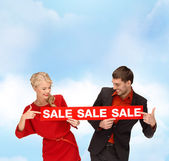 Woman and man with red sale sign — Stock Photo