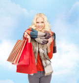 Lovely teenage girl with shopping bags — Stock Photo