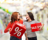 Smiling teenage girl with percent and sale sign — Stock Photo