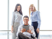 Business team working with tablet pc in office — Stock Photo