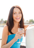 Laughing girl with champagne glass — Stock Photo