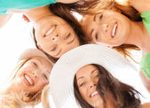 Faces of girls looking down and smiling — Stock Photo