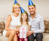Happy family with gift box — Stock Photo