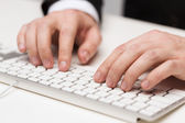 Businessman working with keyboard — Stock Photo