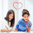 Mother and daughter drawing — Stock Photo #38739555